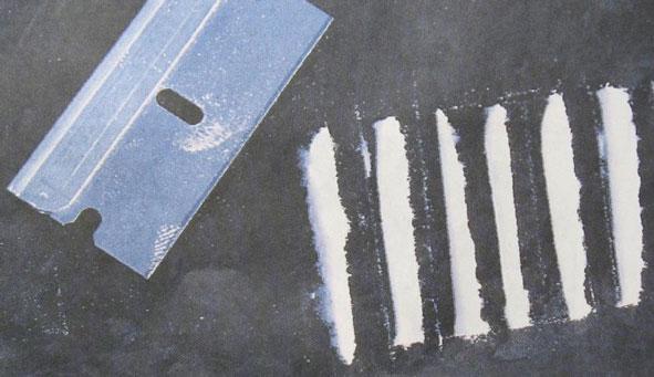 Razor with lines of cocaine