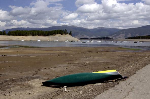 Boat overturned on dry lake bed.