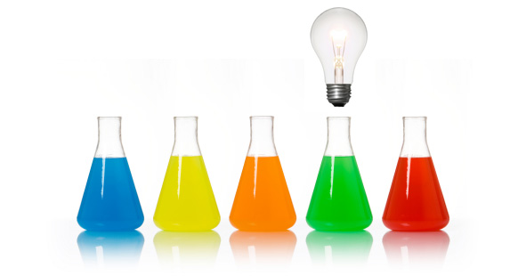 Beakers with a light bulb above