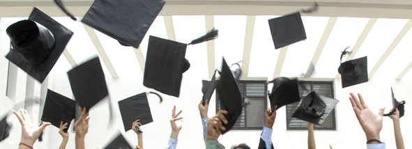 Grads tossing their hats in the air