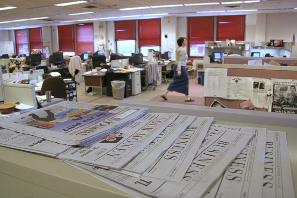 Newspapers in a newsroom