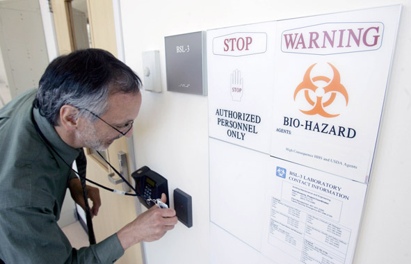 scientist swiping card to access secure biosafety lab