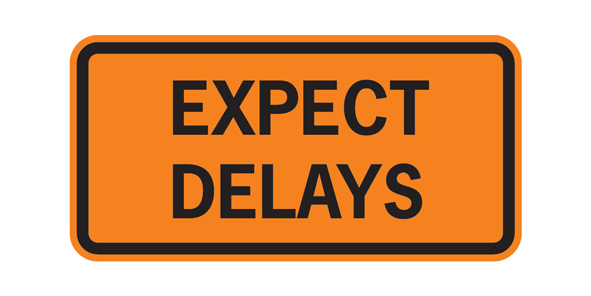 orange traffic sign reading Expect Delays