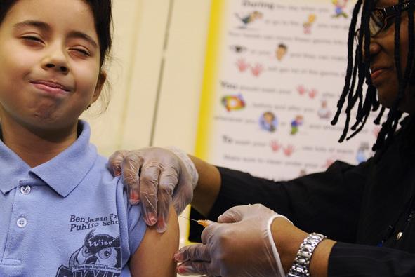 girl receiving H1N1 vaccine