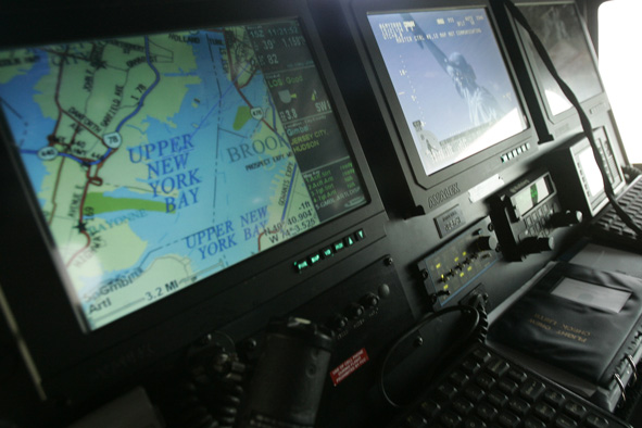 The Statue of Liberty appears on one screen and a map of New York on another in the New York Police Department's surveillance helicopter, Tuesday, May 6, 2008, in New York.