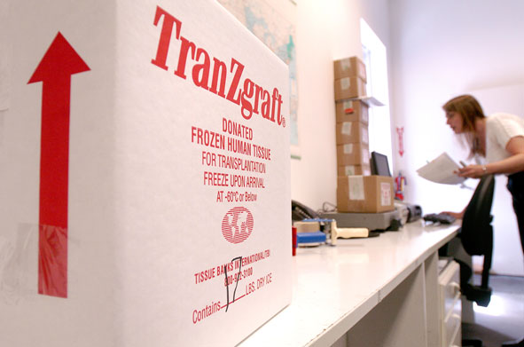 Distribution coordinator Abigail Wilson prepares an outgoing shipment of processed tissue at Tissue Banks International's San Rafael, Calif., facility on Friday, May 12, 2006.