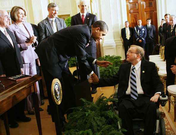 President Barack Obama shakes hands with Rep. Jim Langevin, (D-RI), after signing an Executive Order on stem cells and a Presidential Memorandum on scientific integrity, Monday, March 9, 2009, in the East Room of the White House in Washington.
