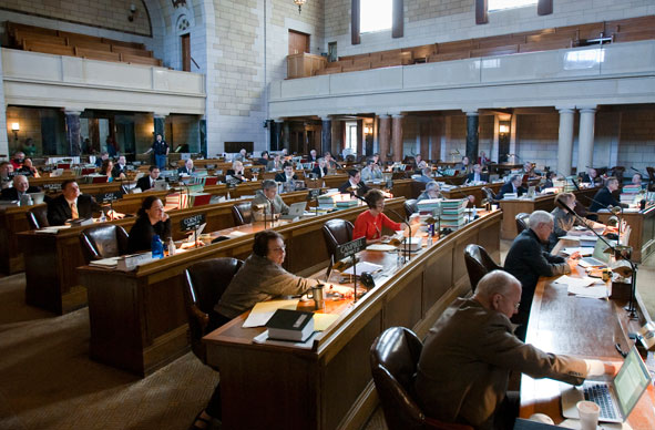 Nebraska lawmakers vote on a bill following a final reading, in Lincoln, Neb., Friday, April 9, 2010